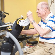 Arm Bike with older man at Optimum Performance Physical Therapy