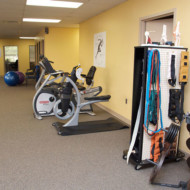 Arm bike in physical therapy clinic
