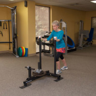 Woman pushing physical therapy sled